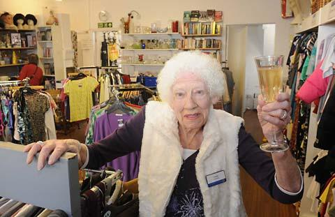 Violet Armitage in the St Leonard's Hospice charity shop in Tang Hall, York, where she had worked as a volunteer for almost 20 years, toasting her 90th birthday earlier this year
