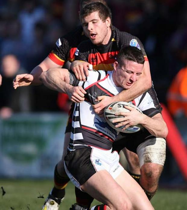 York City Knights player-coach Chris Thorman is collared by the Dewsbury Rams defence. Picture: Gordon Clayton