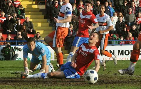 There is frustration etched on the face of York City striker Matthew Blinkhorn as he fails to connect with a cross, while Luton goalkeeper Mark Tyler is relieved to see the chance go begging