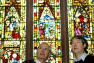 Churchwardens David Titchener, left, and Dr Robert Richards admire the stained glass at All Saints' Church