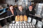 ohn Waddington, managing director, centre, Steve Bielby, works manager, right, and Vanessa Boyes, sales office manager, left, celebrate a    century in business.