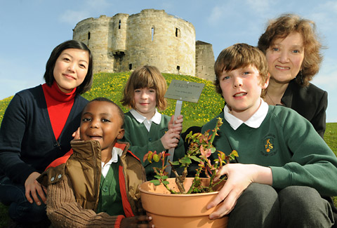 Knavesmire Primary School pupils with cast members of The Souvenir d'Anne Frank, Azusa Ono, left, and Elizabeth Mansfield, in front of Clifford's Tower with the rose that was planted in Tower Gardens