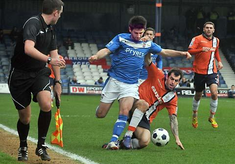 Luton's Alex Lawless tackles York City's Paddy McLaughlin in the FA Trophy semi-final second leg at Kenilworth Road