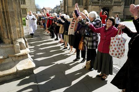 "York Minster got a big ""hug"" as hundreds of people gathered around the building following the annual Lady Day service."