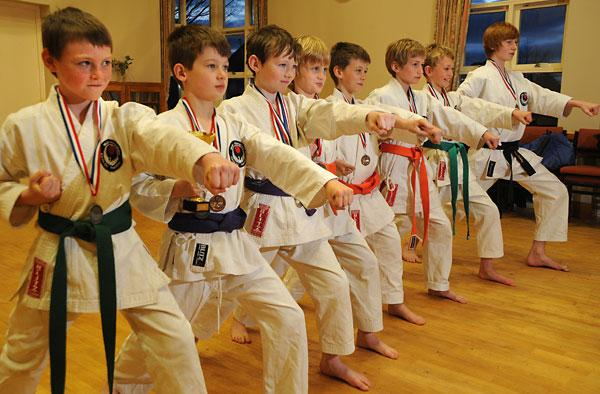 Members of Bishopthorpe's Kaisho Karate Club parade medals they won at the WIKF British National Championships.