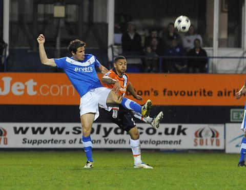York City centre-back Chris Doig gets a foot in to foil Luton Town goalscorer Andre Gray in last night's Blue Square Bet Premier clash at Kenilworth Road