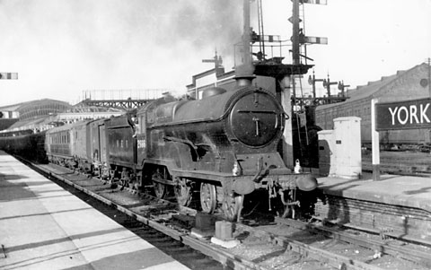 A D11/1 class 4-4-0 (No 2666 Zeebrugge) pulls out of York on an express service