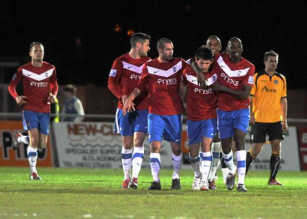 York City celebrate Paddy McLaughlin's free-kick equaliser at Newport County