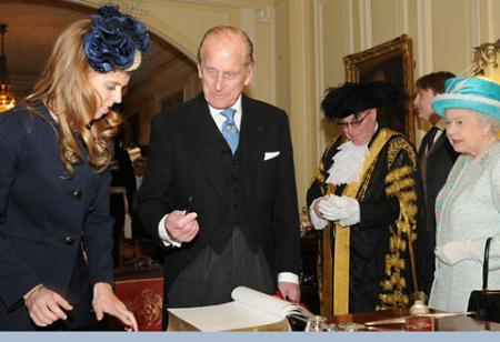 Princess Beatrice, Prince Philip, Lord Mayor Coun David Horton and The Queen during the signing of the book at the Mansion House.
