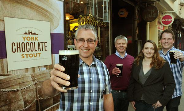 Rudgate Brewery's Craig Lee raises of York Chocolate Stout, with Sophie Jewett, from York Cocoa House, and Gary Brown, left, and Mat Lazenby, from LazenbyBrown