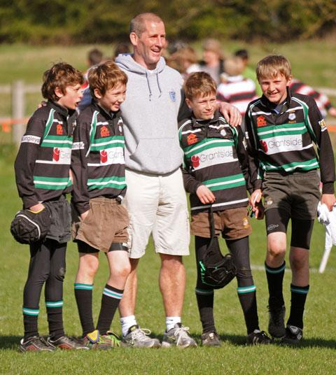 England rugby union coach Stuart Lancaster is pictured with a quartet of York youngsters at the club's junior  tournament at Clifton Park