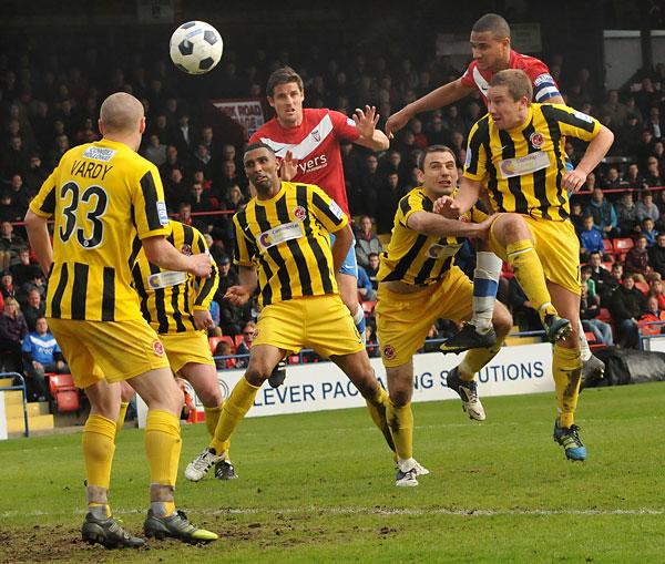 York City captain James Meredith, above, sees his header cleared off the line by Fleetwood's Shaun Beeley