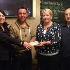 York Press: Quiz organiser Helen Powell and landlord Sean Singleton are pictured with Dilys and Chris Hart, the parents of Marine David Charles Hart