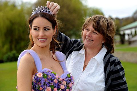 Florist Sara Collinge puts the finishing touches to the diamond jubilee flower dress modelled by Natasha Andriotis