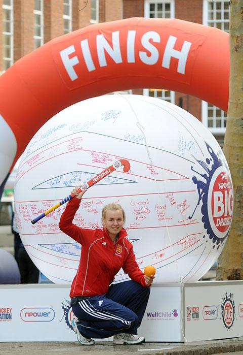 Right, England under-16 hockey player Megan Roe with the giant hockey ball on display at the Big Dribble in York.