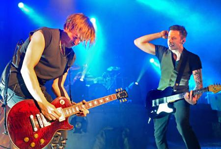 Tom Fletcher, left, and Danny Jones of McFly performing at York Barbican.