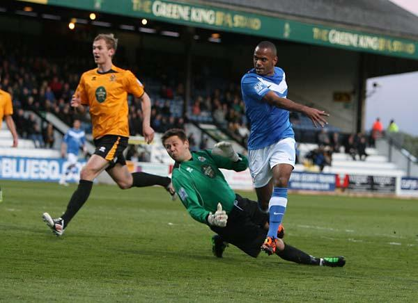 York City's Lanre Oyebanjo beats Cambridge 'keeper Danny Naisbitt but hits the side-netting. Picture: Gordon Clayton