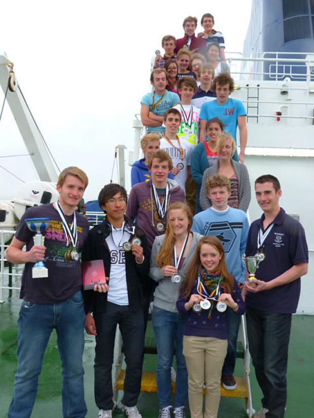 St Peter's School rowers show off their medal haul in Belgium