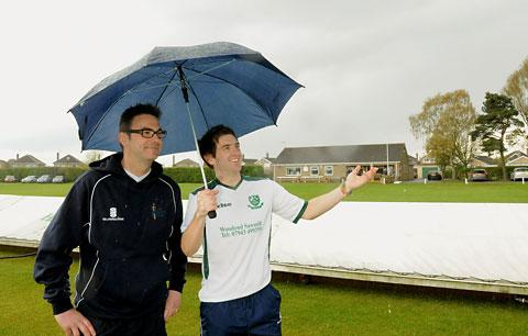 York II  captain Marcus Wood, left, and Stamford Bridge skipper Matthew Beckett watch the rain fall