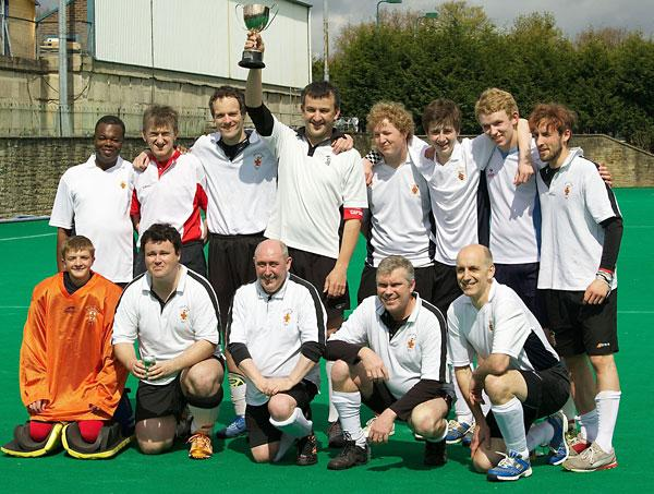 City of York Hockey Club men's VIII  celebrate their League E Cup final success.
