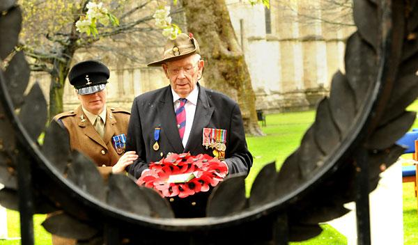 Veteran John Skene, 93, lays a wreath during the Kohima memorial service at York Minister yesterday, helped by Sgt Marie Bailey