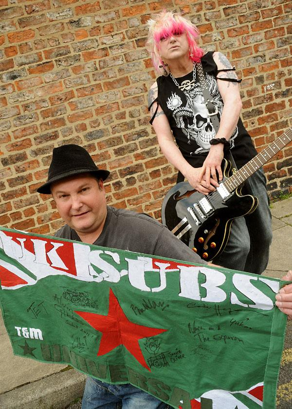 UK Subs fan Rob Kimber with the flag he has had autographed by former UK Subs drummer Stevie Ze Suicide, who lives in York