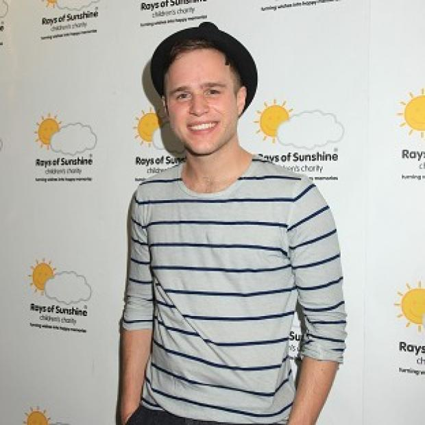 Olly Murs would love to sing with Stevie Wonder and Madness