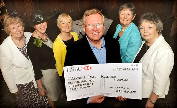 Stephen Bellamy with the cheque which he donated to the Selby Committee of Yorkshire Cancer Research