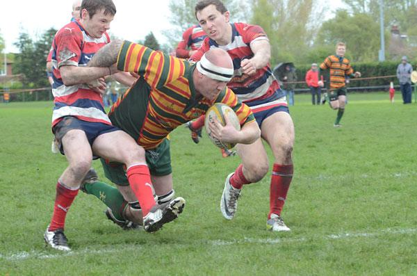 Selby RUFC's Martin Protheroe, left,  crashes over the line for his side's  decisive third try in the Yorkshire Shield semi-final against Barnsley at Sandhill Lane