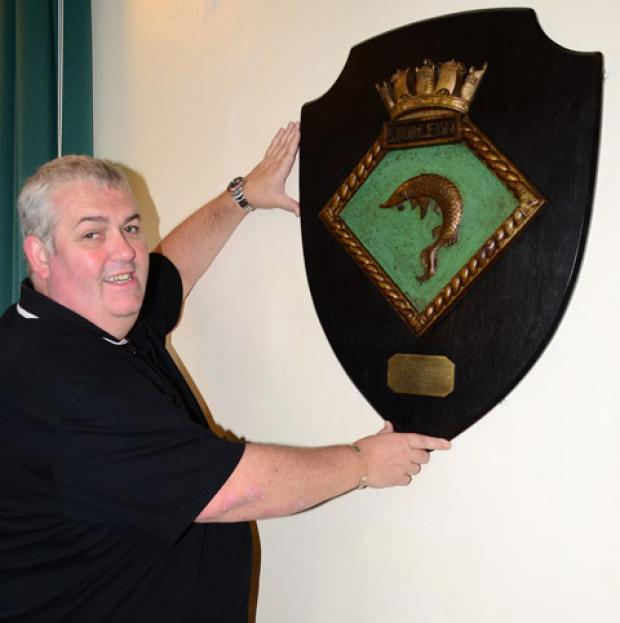 Coun Steve Shaw-Wright with the restored shield
