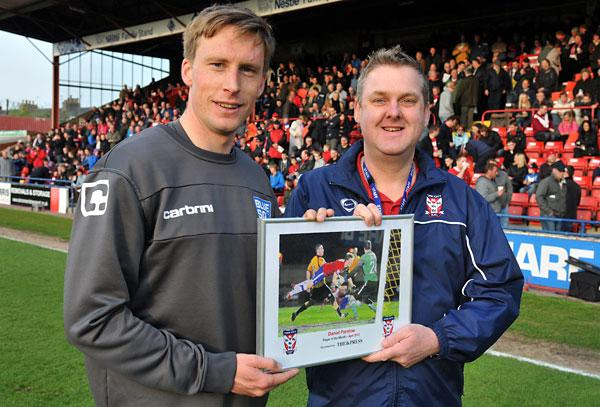 Daniel Parslow receives his award from supporter Matt Pope