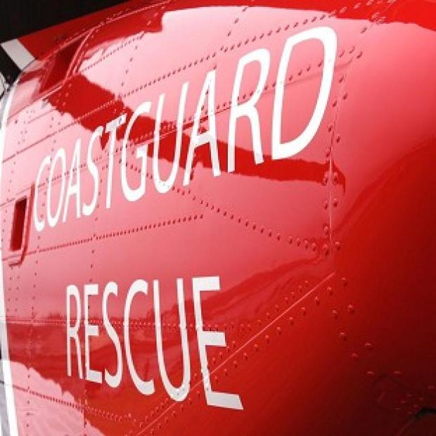 A walker has died after falling down a cliff in Cornwall, the Coastguard said