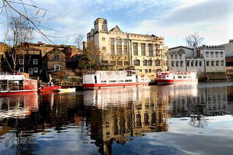 The Guildhall reflecting in the River Ouse