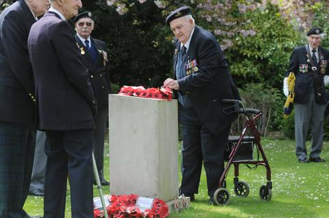 Cyril Howard, chairman of the York branch of the Normandy Veterans Association, adjusts the wreath he laid in York's Memorial Gardens
