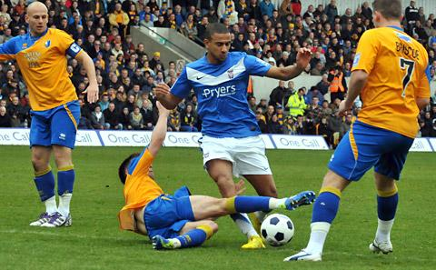 Man of the match James Meredith tries to weave his way through the Mansfield Town ranks