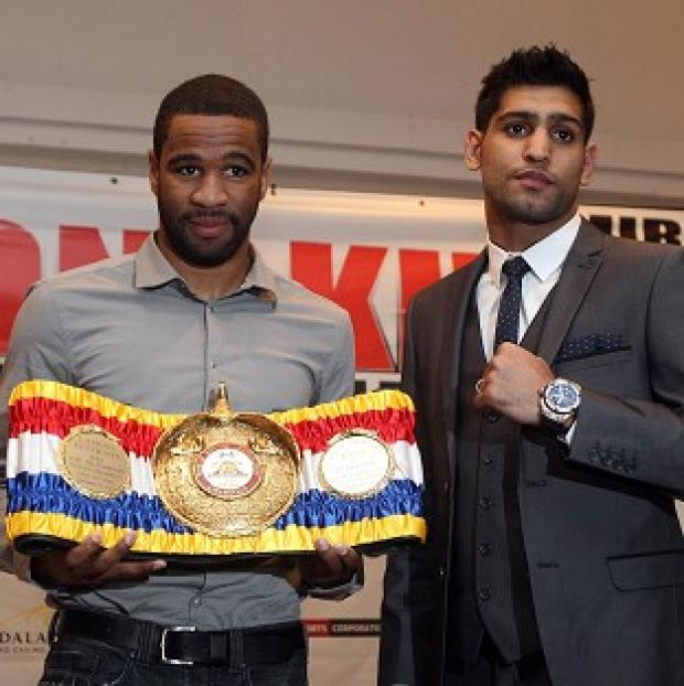 Lamont Peterson (left) and Amir Khan