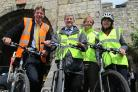 Saddled up for the Olympic Torch, from left, are  Graham Titchener, programme manager i-Travel York; Coun Dave Merrett; Shaun Wilkinson, road safety training co-ordinator; Jayne Ward, school crossing patrol supervisor