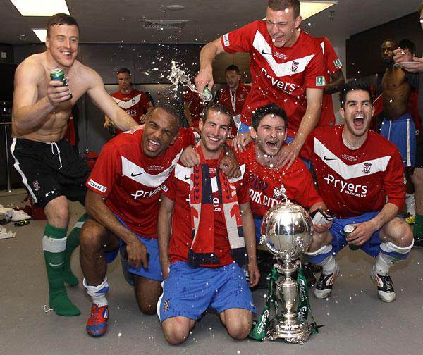 York City heroes, from left, Michael Ingham, Lanre Oyebanjo, Matty Blair, Paddy McLaughlin and Jon Challinor, with Ben Gibson behind, celebrate with the FA Trophy in the Wembley dressing room.  Picture: Lewis Outing