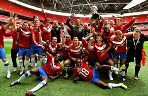Paddy McLaughlin, front, joins in City's FA Trophy celebrations