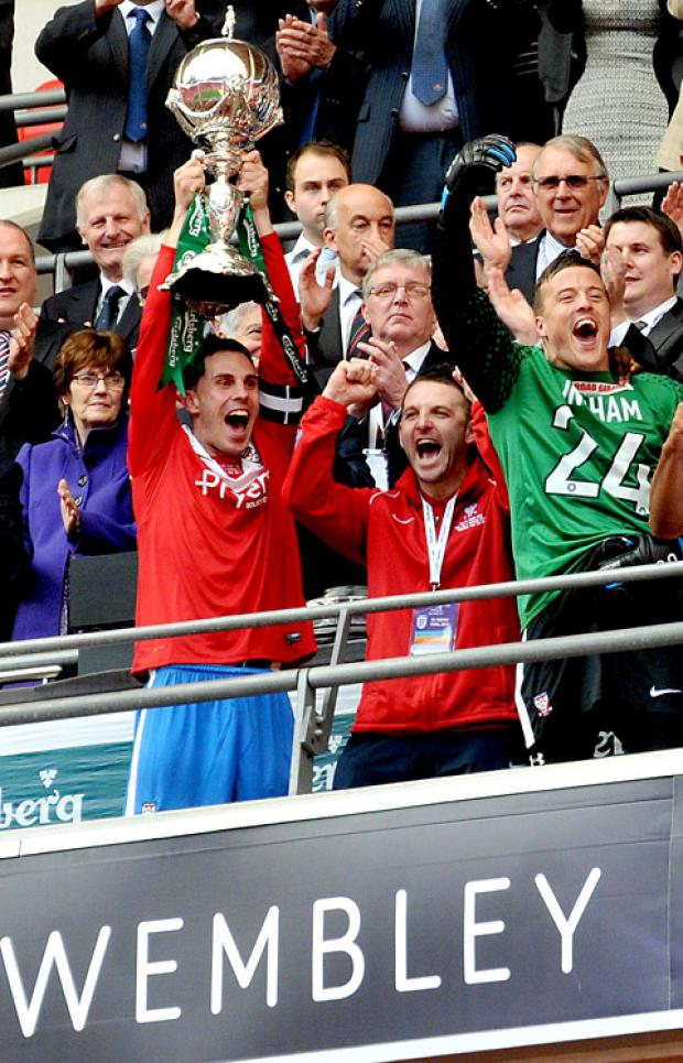 Chris Smith lifts aloft the FA Trophy joined by Scott Kerr