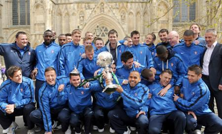 York City players pose with the FA Trophy cup outside York Minster, on the way to a civic reception at the Mansion House.