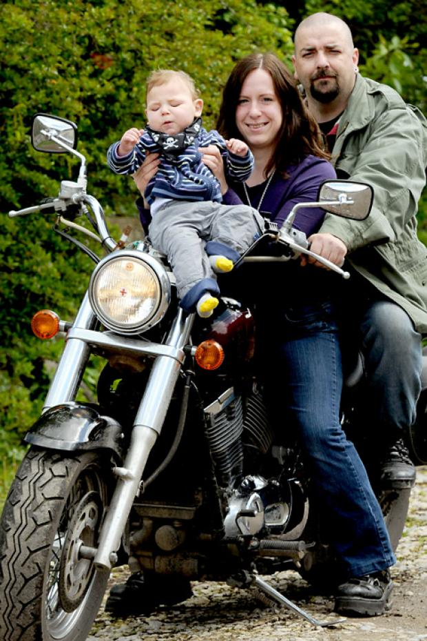 "Joanna Chambers and her son William with Stuart ""H Bomb"" Harper of the Demented Hamster Motorcycle Club, ready for the fundraising bike rally"