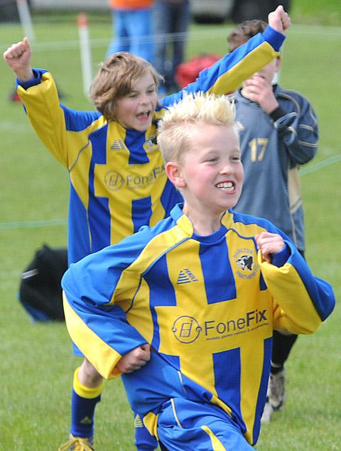 Hamilton Panthers Blues players  celebrate a goal at the Poppleton Boys Festival of Football Gala at Millfield Lane