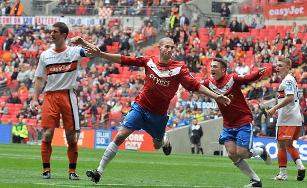 York City goal hero Matty Blair  celebrates his winning goal  two  minutes into the  second half of the play-off final  victory over Luton Town at Wembley