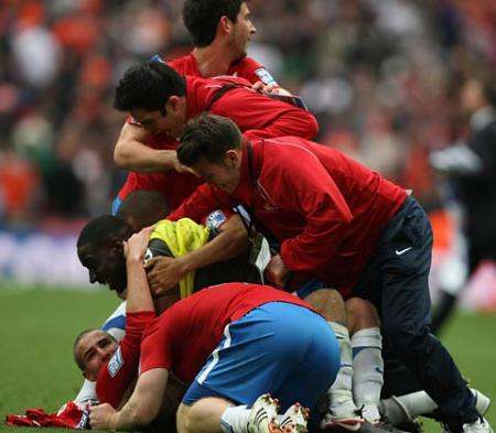 York City players pile on Matty Blair