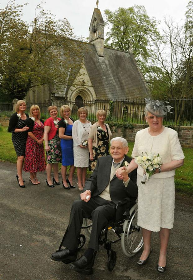 Thomas and Margaret Hunter, who renewed their vows at Skelton church after 60 years of marriage, with daughters, from left, Jayne, Debbie, Michelle, Bev, Carol and Lynn