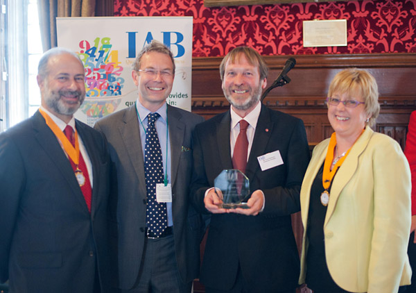 Tony Robinson with trophy, and, from left, Fabian Hamilton, MP and the IAB President, Stephen Pegge, head of external affairs at Lloyds TSB Commercial and Janet Jack, chair of the IAB council