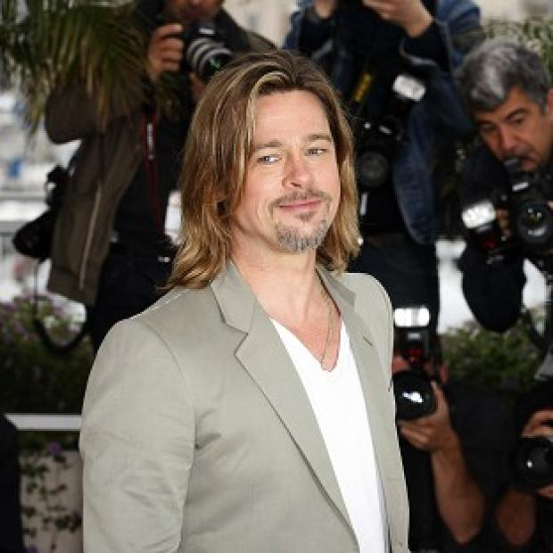 Brad Pitt says he and Angelina Jolie have not set a date for their wedding