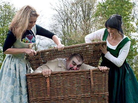 Clive Lyons as Falstaff with Victoria Delaney as Mistress Page and Clancy McMullan as Mistress Ford in Yake Shakespeare Project's outdoor production of The Merry Wives Of Windsor