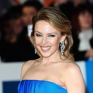 Kylie Minogue has celebrated her 25th year in pop music, and her birthday, with an Outstanding Contribution gong
